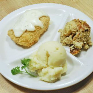 Stuffed Chicken Dinner with two sides